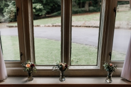 Window flowers at Whirlowbrook hall wedding venue