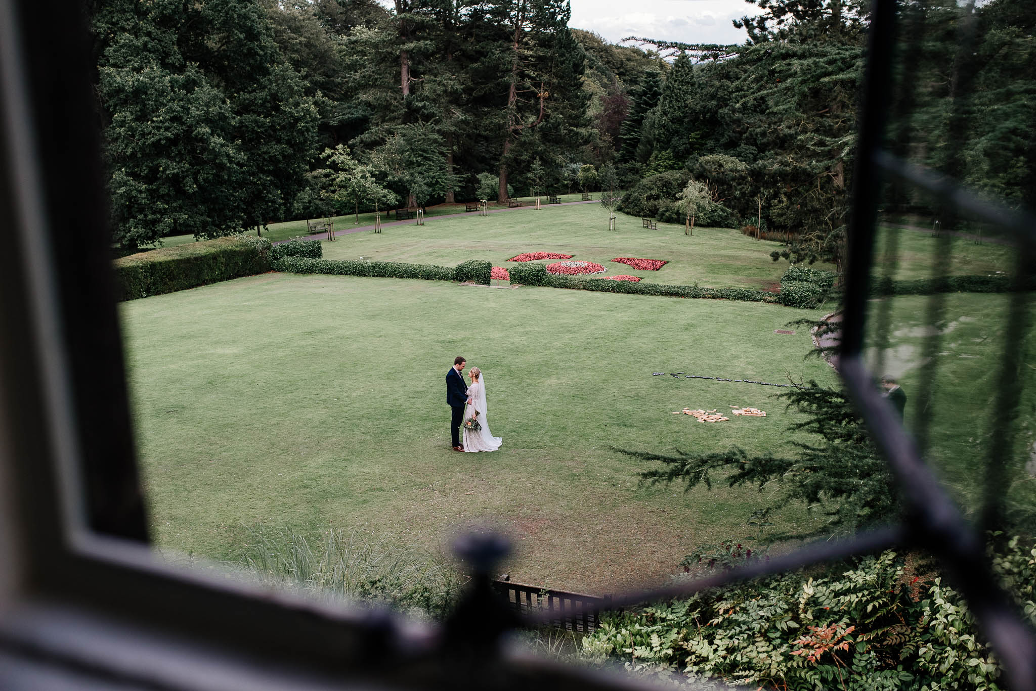 Newlyweds in garden at Whirlowbrook Hall