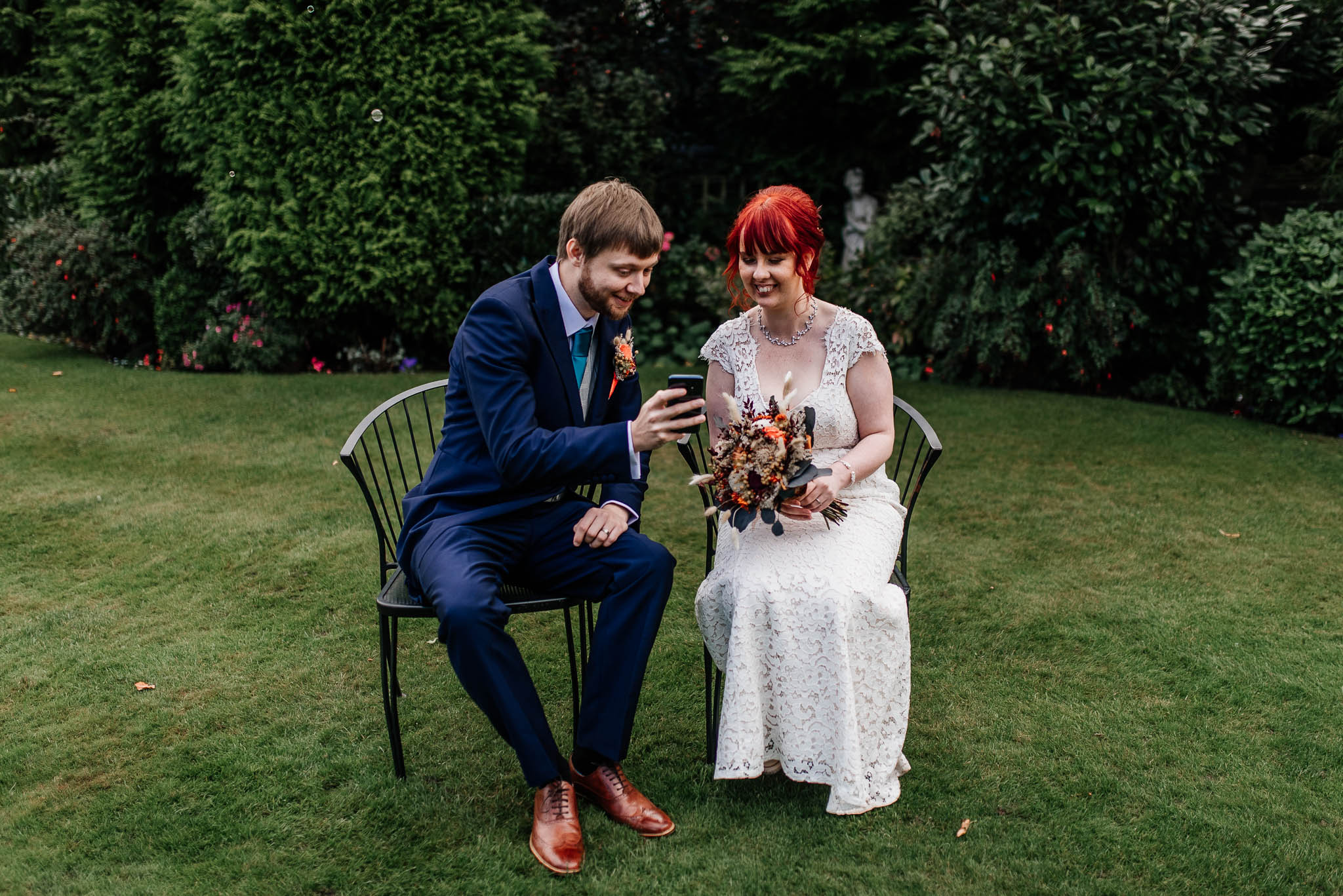 Bride and groom with a smartphone