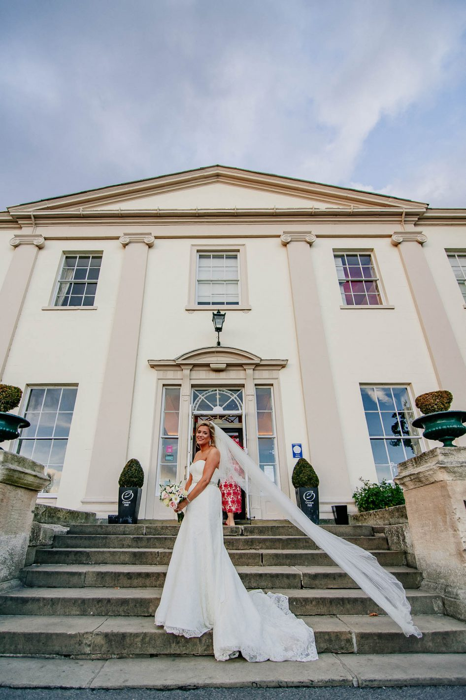 Bride with veil outside Owston Hall Wedding venue in Doncaster