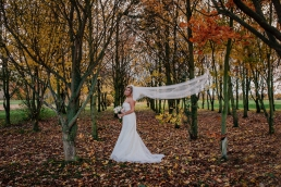 Bride with blowing veil at Owston Hall