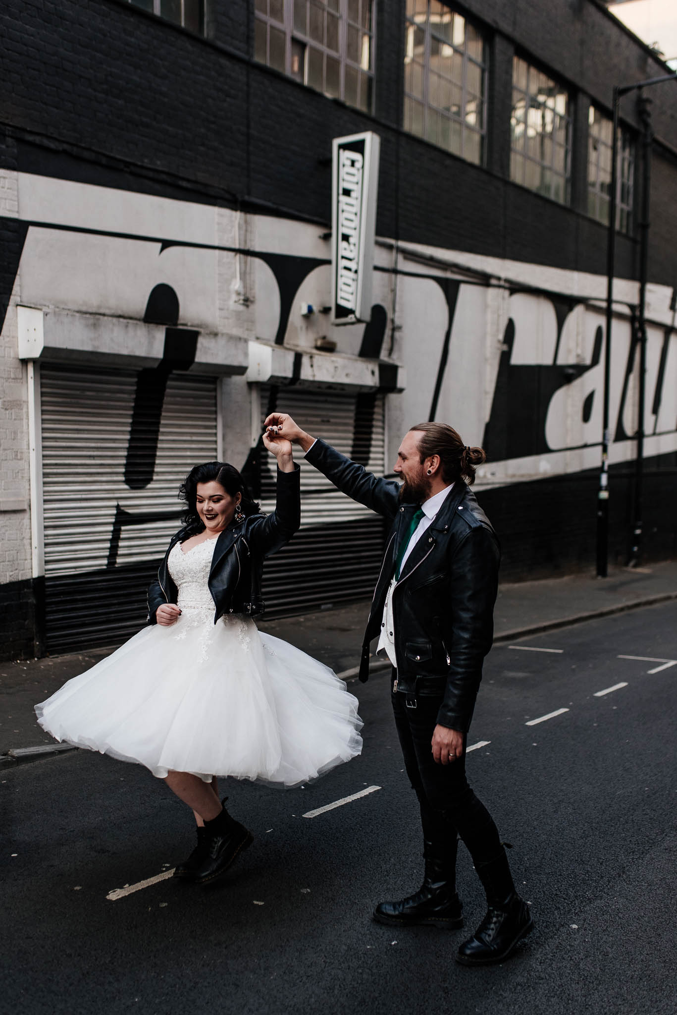 Bride and groom dancing during a post wedding shoot in Sheffield