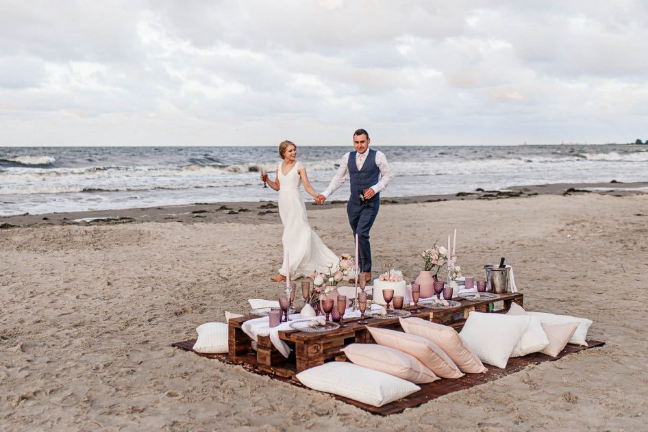 Married couple after a beach wedding