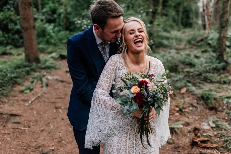 Doncaster wedding photographer with a newly married couple in woodland