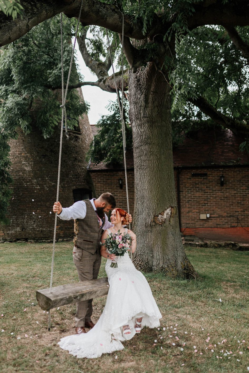Newly married couple on a tree swing at Fishlake Mill