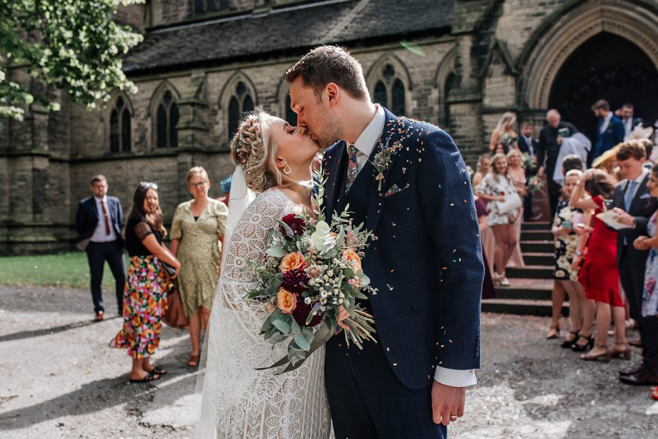 wedding photography of a newly married couple outside a church near Rotherham